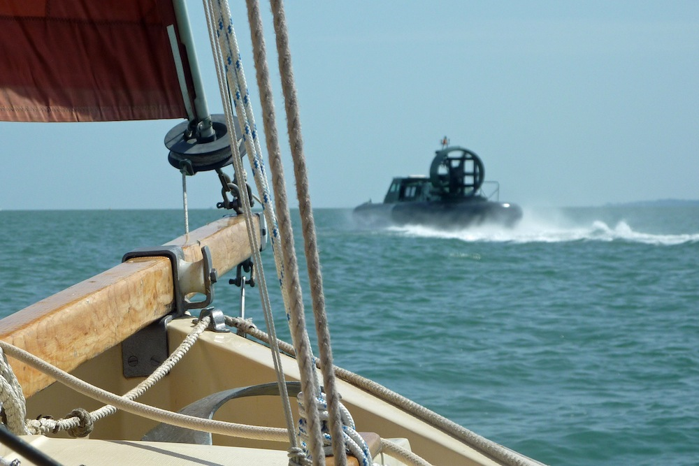 'Nutmeg' is overtaken by a hovercraft on passage back to Keyhaven Photo: Viv Head