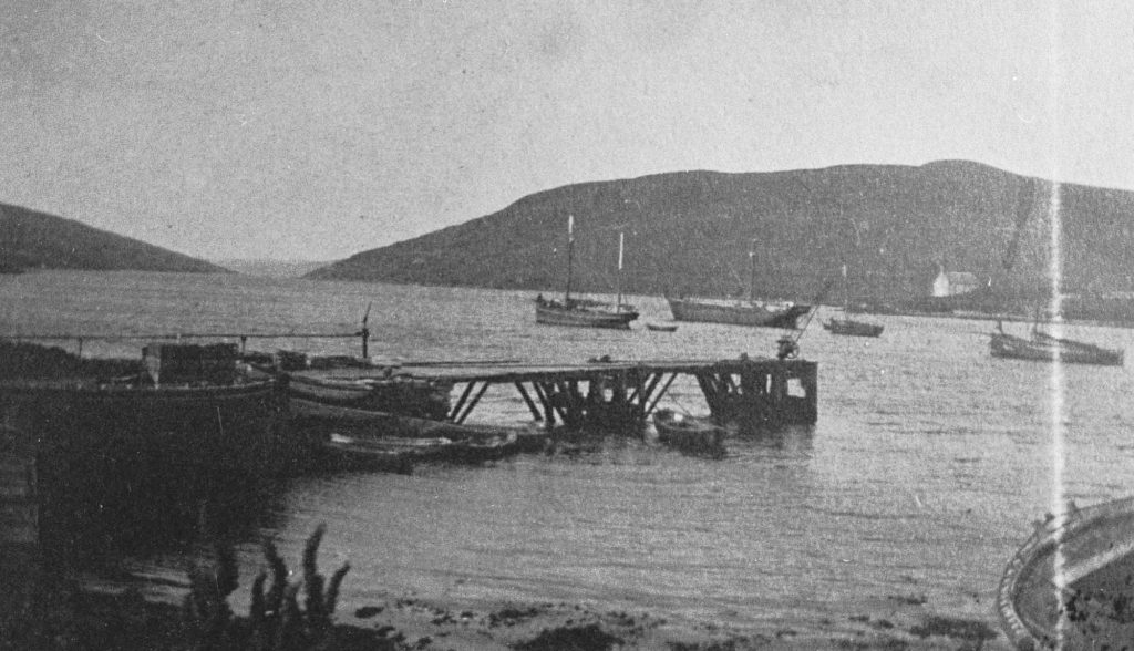 Adie's Pier, with Cod Smack, Cargo Boat and Drifter lying off in Voe Photo: Shetland Museum and Archives